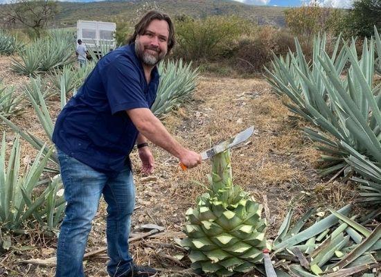John Swartz in an agave field