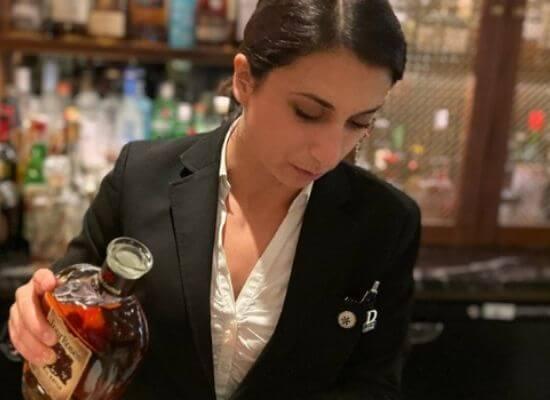 Mariantonoietta Varamo in action behind the bar
