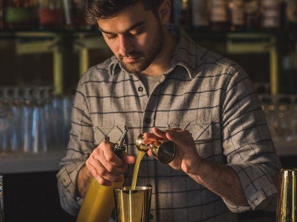 Emilio Salehi pouring a cocktail